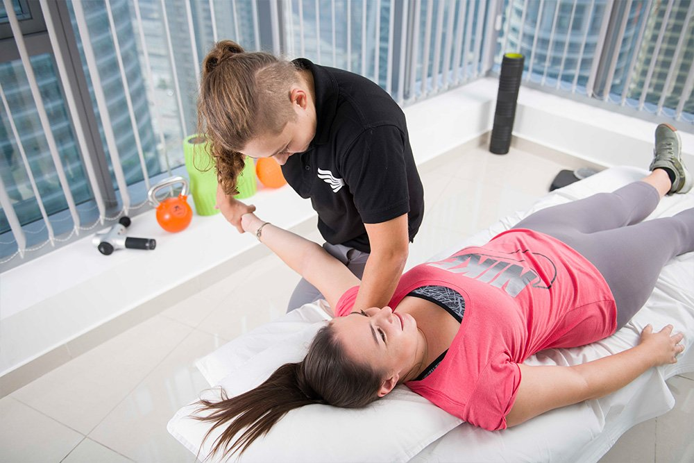 lady physiotherapy with a female patient